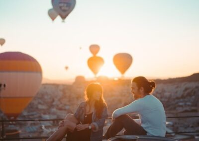people-sitting-on-rooftop-during-sunset-3889742